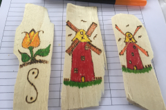 Some of the bookmarks we make from wood shavings to give to the kids.