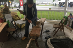 Luke working on his bench will the rain continued